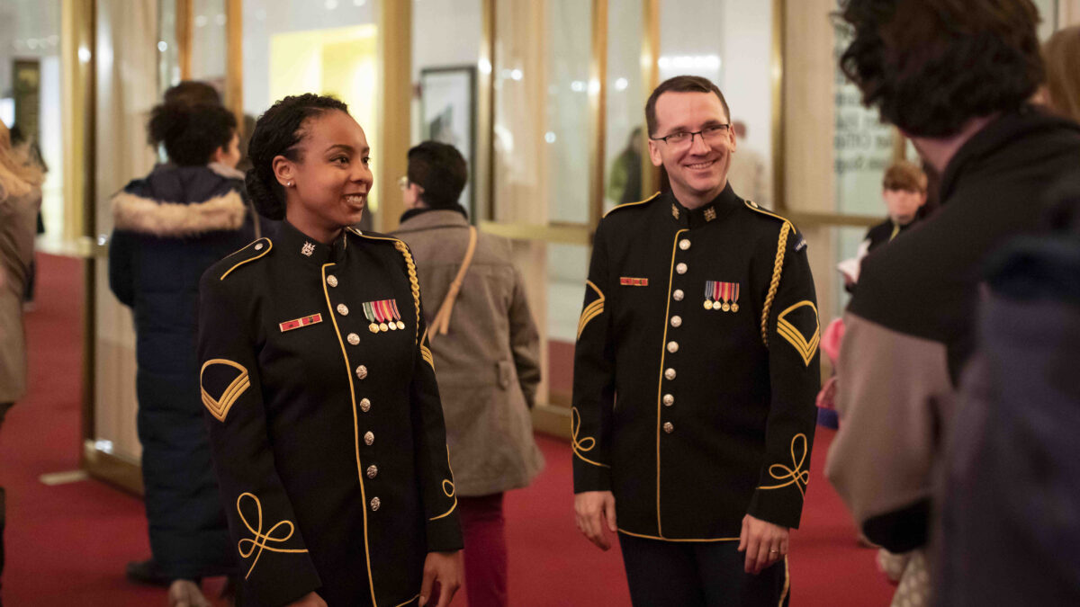 SFC Adiza Jibril and SSG Nicholas Starr greet audience members after a recital at the Kennedy Center's Millennium Stage.