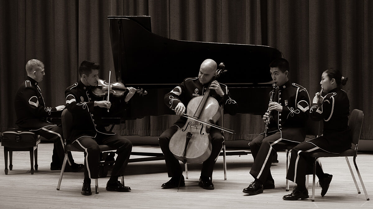Five members of the Chamber Players performing (Piano, violin, cello, clarinet, flute)
