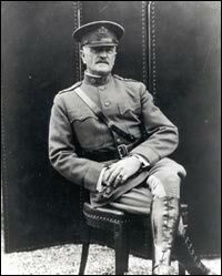 General John J. Pershing sitting in a chair